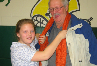 Grade 6 Summitview student Emily scarfs her grandfather Tom Winters